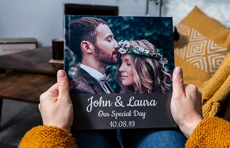 Custom printed Printerpix photo album with hard cover and large photos of old couple