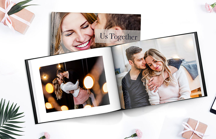Personalised photo album book with romantic pictures of a couple and photo cover