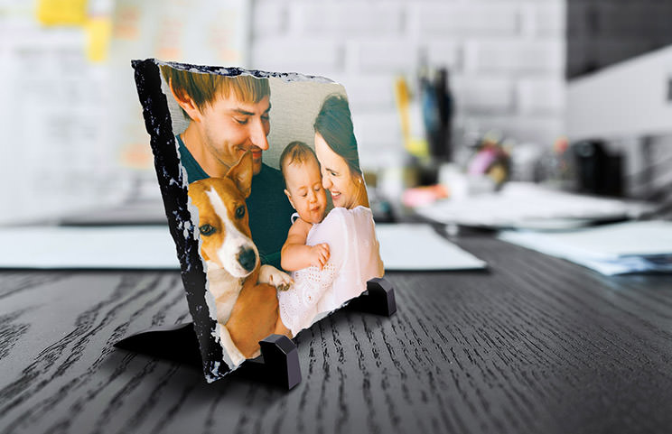 side view of stone slate with baby and mum and dad