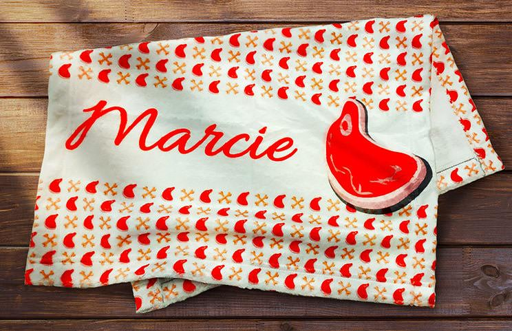 Folded personalised dog blanket with dog name on and picture of dog food