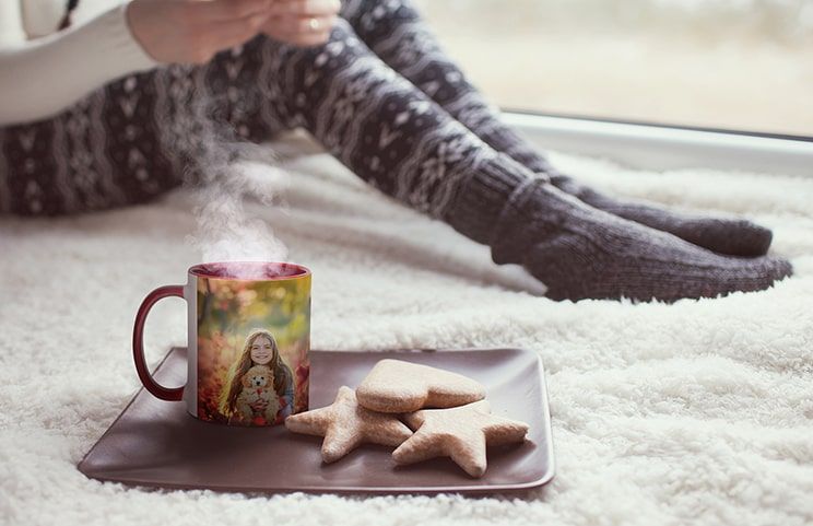 Personalised red mug with photo of young girl on next to cookies