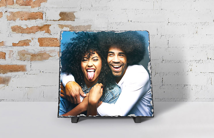 two young people printed on a stone