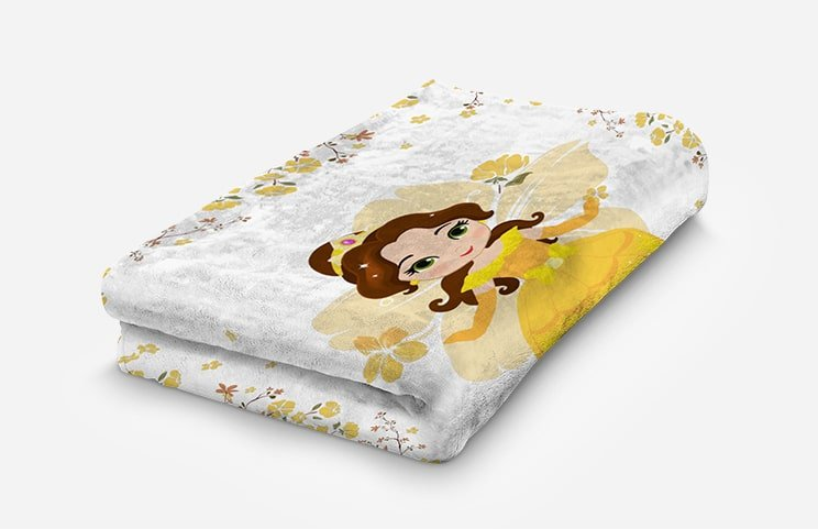 Young woman in bed with a white and yellow personalised princess blanket