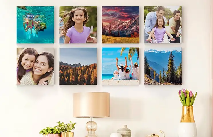 Living room with two photo canvases above sofa with baby photos