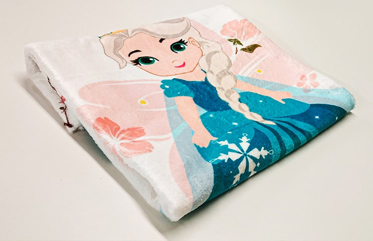 Close up photo of blue folded custom elsa princess blanket by Printerpix
