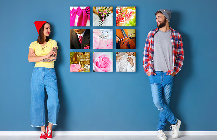 Couple in front of blue wall with nine square photo canvases on