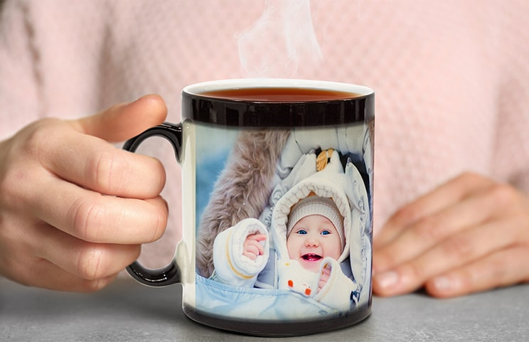 Personalised magic mug with revealed photo of young woman